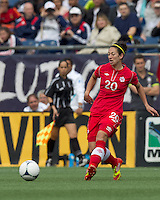 Canadian player Marie-Eve Nault (20) passes the ball. In an international friendly, Canada defeated Brasil, 2-1, at Gillette Stadium on March 24, 2012.