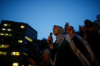 New York City, NY. 20 August 2014. A woman speakes as she takes part during a Pro-palestine Rally across de Brooklyn Bridge in Manhattan.  Photo by Kena Betancur/VIEWpress