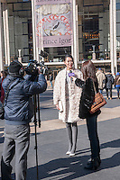 A fashionista in their finery is interviewed by Chnese media outside of the Fall 2014 Fashion Week shows in Lincoln Center in New York on Saturday, February 8, 2014. This year some designers are abandoning the tents at Lincoln Center to hold their shows at far flung venues, including Brooklyn.  (© Richard B. Levine)