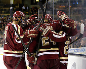 Isaac MacLeod (BC - 7), Bill Arnold (BC - 24), Quinn Smith (BC - 27) - The Boston College Eagles defeated the Harvard University Crimson 4-1 in the opening round of the 2013 Beanpot tournament on Monday, February 4, 2013, at TD Garden in Boston, Massachusetts.