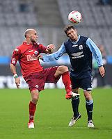 Fussball 2. Bundesliga:  Saison   2012/2013,    16. Spieltag  TSV 1860 Muenchen - SC Paderborn  27.11.2012 Daniel Brueckner (li, SC Paderborn 07)  gegen Moritz Volz (1860 Muenchen)