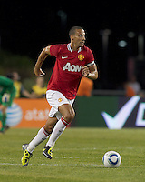 Manchester United FC defender Rio Ferdinand (5) brings the ball forward. In a Herbalife World Football Challenge 2011 friendly match, Manchester United FC defeated the New England Revolution, 4-1, at Gillette Stadium on July 13, 2011.