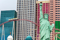 Las Vegas, Nevada.  Statue of Liberty Replica in front of New York New York Hotel and Casino, Roller Coaster in the background.