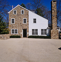 This basic stone house, built in 1800, has a clapboard extension