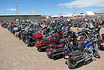 RAPID CITY, SOUTH DAKOTA - AUGUST 2010:  Motorcycle's are parked for as far as the eye can see at the local Harley Davidson dealership in Rapid City during the 70th annual Sturgis Motorcycle Rally held in the Black Hills.  The attendance estimates were placed between 500, 000 and 700,000 bikers.