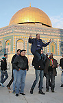 Ahmad Khalaf is greeted by friends outside al-Aqsa mosque after he was released from an Israeli prison, in Jerusalem's old city December 31, 2013. Israel freed 26 Palestinian prisoners on Tuesday, days before U.S. Secretary of State John Kerry was due back in the Middle East to press the two sides to agree a framework peace deal. Photo by Saeed Qaq