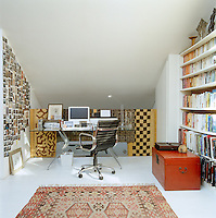 Tucked away on one side of the mezzanine bedroom there is enough space for a desk with one wall used as a display area for works-in-progress and the other for a large collection of books