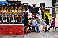 Teenagers hang about the clock tower in the main square in Thimphu.