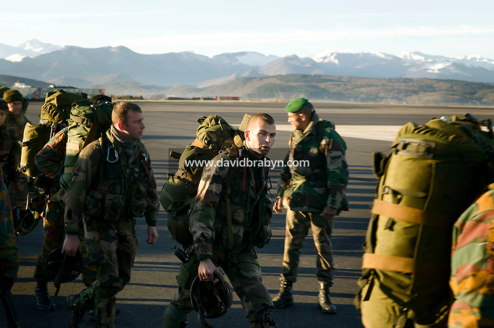 Members of the French Foreign Legion and soldiers from Belgium (with yellow markings in uniforms) walk across the tarmac during a full scale European multi-force exercise held at the airport of Tarbes, France, 12 December 2007.