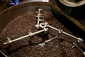 December 20, 2011. Durham, NC.. Beans roasting.. With the rising price of coffee worldwide and new fair trade regulations making it more difficult to get ethically traded coffee, how does local roaster Counter Culture maintain their mission and ethics?.
