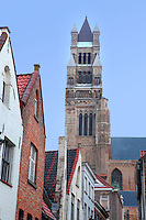 BRUGES, BELGIUM - FEBRUARY 08 : A low angle view of a narrow street with the Cathedral of Saint Sauveur (St. Salvator) in the background on February 08, 2009 in Bruges, West Flanders, Belgium. The St. Salvator Cathedral was started in 1280 and was ended in 1350. It is one of the largest and oldest churches in Bruges. (Photo by Manuel Cohen)