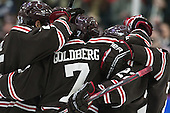 The Bears celebrate Jake Goldberg's (Brown - 7) goal. - The visiting Brown University Bears defeated the Harvard University Crimson 2-0 on Saturday, February 22, 2014 at the Bright-Landry Hockey Center in Cambridge, Massachusetts.