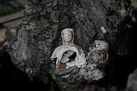 A broken Buddha statue sits in a prayer area of the Giac Vien Pagoda in Ho Chi Minh City, Vietnam. Photo taken Monday, May 3, 2010...Kevin German / LUCEO