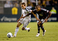 LA Galaxy midfielder Eddie Lewis attempts to move around DC United defender Jordan Graye. The LA Galaxy defeated DC United 2-1at Home Depot Center stadium in Carson, California on Saturday September 18, 2010.