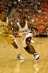 3 APR 2004: Oklahoma State guard John Lucas (15) drives to the basket past Georgia Tech forward Anthony McHenry (55) during the Division I Men's Basketball semi-final game held at the Alamodome in San Antonio, TX. Georgia Tech defeated Oklahoma State 67-65 to advance to the championship game. Ryan McKee/NCAA Photos