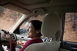 December 16, 2010. Raleigh, NC.. Renuka Adhikari, the wife of TP Mishra, talks on the phone as he drives her to her second job. Nearly everyday, he picks her up from one job and then drops her at the next. . TP Mishra, a refugee from Bhutan, has recently relocated from the Bronx to Raleigh, where he lives in an suburban apartment  with his wife, as well as another Bhutanese couple.