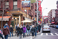 A tour group walks along Mulberry Street in the Little Italy neighborhood of New York on Sunday, March 30, 2014. Changing demographics and sharp rent increases have decimated the Little Italy neighborhood reducing the once thriving Italian enclave from a fifty-block area into a short three blocks mostly populated by tourist oriented businesses. Eight restaurants have closed in the past year as their leases came up and negotiations with landlords were fruitless. As Chinatown moves north many Italian businesses had been displaced by businesses catering to their Asian customers. (© Richard B. Levine)