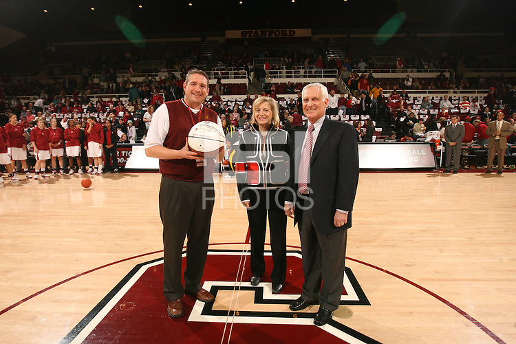 31 January 2008: David Hubbard (left) presents the Game Sponsor Game Ball to the Stanford Hospital & Clinic representatives during Stanford's 77-51 win against the USC Trojans at Maples Pavilion in Stanford, CA.