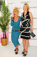Betsey Johnson, and Carole Hochman laughing on stage at the CURVE and CFDA Party For A Cause event during the CURVENY Lingerie & Swim show, at the Jacob Javits Convention Center, August 2, 2010.