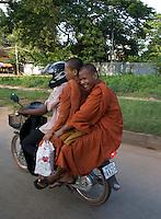 Siem Reap street scene, Monks on the back of a Motor Bike, Cambodia