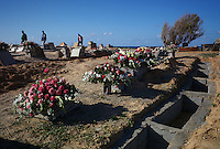 Tripoli, Libya, March 21, 2011.Empty graves and faded flowers at a seaside cemetery 24 hours after a funeral ceremony allegedly held for 25 victims of the first bombing day. The day before, Libyan Foreign Media department took foreign journalists to 'show air strike victims funerals' to that location, but no bodies and no families ever appeared...