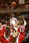 31 January 2004  Marcus Arnold rises above a crowd of Braves to get a close shot at the bucket. Bradley University visit Redbird Arena in Normal Illinois, home of the Illinois State University Redbirds.
