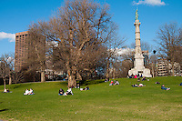 The Soldiers and Sailors Monument and people picknicking on the lawn in Boston Common park