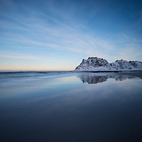 Mountain reflection on Uttakleiv beach, Vestvågøy, Lofoten Islands, Norway