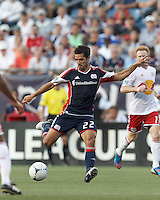 New England Revolution forward Benny Feilhaber (22) fakes shot and passes. In a Major League Soccer (MLS) match, New England Revolution defeated New York Red Bulls, 2-0, at Gillette Stadium on July 8, 2012.