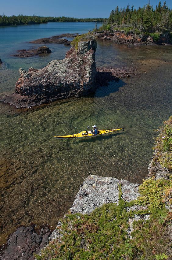 A kayaker explores the rugged shoreline of Lake Superior at Isle Royale National Park.