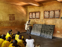 Inmates taking primary level biology lessons in Kirinya Main Prison. The inmate in white is on death row. The facility was built in colonial times for 336 inmates but now holds 898 convicts plus 24 on remand.