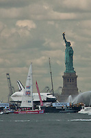 Space Shuttle Enterprise passes next to statue of liberty on its way up the Hudson River to be placed at the Intrepid Sea, Air and Space Museum in New York, June 6, 2012. / VIEW..