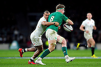 Jamie Heaslip of Ireland is tackled by Jonathan Joseph of England. RBS Six Nations match between England and Ireland on February 27, 2016 at Twickenham Stadium in London, England. Photo by: Patrick Khachfe / Onside Images