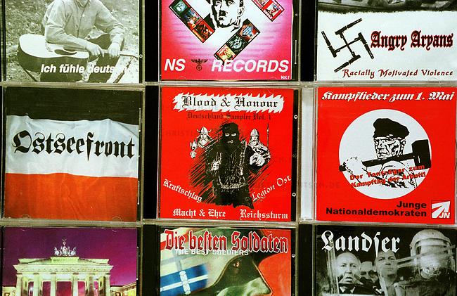 Neonazi Musik-CD's.<br /> Die oftmals in Osteuropa produzierten CD's werden in der Skinhead- und Neonazi-Szene zu horrenden Preisen Preisen verkauft und bescheren den Plattenfirmen phaenomenale Umsaetze. Die CD's enthalten z.T. indizierte und verbotene Musikstuecke.<br /> 19.9.2000<br /> Copyright: Christian-Ditsch.de<br /> [Inhaltsveraendernde Manipulation des Fotos nur nach ausdruecklicher Genehmigung des Fotografen. Vereinbarungen ueber Abtretung von Persoenlichkeitsrechten/Model Release der abgebildeten Person/Personen liegen nicht vor. NO MODEL RELEASE! Nur fuer Redaktionelle Zwecke. Don't publish without copyright Christian-Ditsch.de, Veroeffentlichung nur mit Fotografennennung, sowie gegen Honorar, MwSt. und Beleg. Konto: I N G - D i B a, IBAN DE58500105175400192269, BIC INGDDEFFXXX, Kontakt: post@christian-ditsch.de<br /> Bei der Bearbeitung der Dateiinformationen darf die Urheberkennzeichnung in den EXIF- und  IPTC-Daten nicht entfernt werden, diese sind in digitalen Medien nach &sect;95c UrhG rechtlich gesch&uuml;tzt. Der Urhebervermerk wird gemaess &sect;13 UrhG verlangt.]
