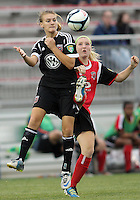 BOYDS, MARYLAND - July 21, 2012:  Ashley Herndon (19) of DC United Women knocks the ball away from Megan Weston (16) of the Virginia Beach Piranhas during a W League Eastern Conference Championship semi final match at Maryland Soccerplex, in Boyds, Maryland on July 21. DC United Women won 3-0.