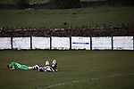 Bacup Borough 4 Holker Old Boys 1, 25/04/2016. Brain Boys West View Stadium, NorthWest Counties League Division One. A collision on heads leaves two players injured during the first-half action at the Brain Boys West View Stadium as Bacup Borough (in black) play Holker Old Boys in a NorthWest Counties League division one fixture. Formed as Bacup in 1879, the club moved into their current home in 1889 and have been known as Bacup Borough since the 1920s, apart from a brief recent spell when they added the name Rossendale to their name. With both teams challenging for play-off places, Bacup Borough won this fixture by 4-1, watched by a crowd of 50. Photo by Colin McPherson.