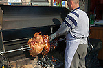 Man cooking Prague ham and other meat on a rotisserie in Old Town Square, Prague, Czech Republic, historical center listed as World Heritage by UNESCO, the old town (Stare Mesto), Old town Square (Staromestske namesti), Europe
