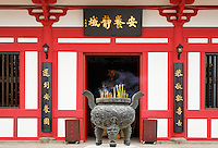 Incense burning in cauldron outside Buddhist temple in Po Fook Hill Cemetery, Sha Tin, New Territories, Hong Kong SAR, People's Repbulic of China, Asia