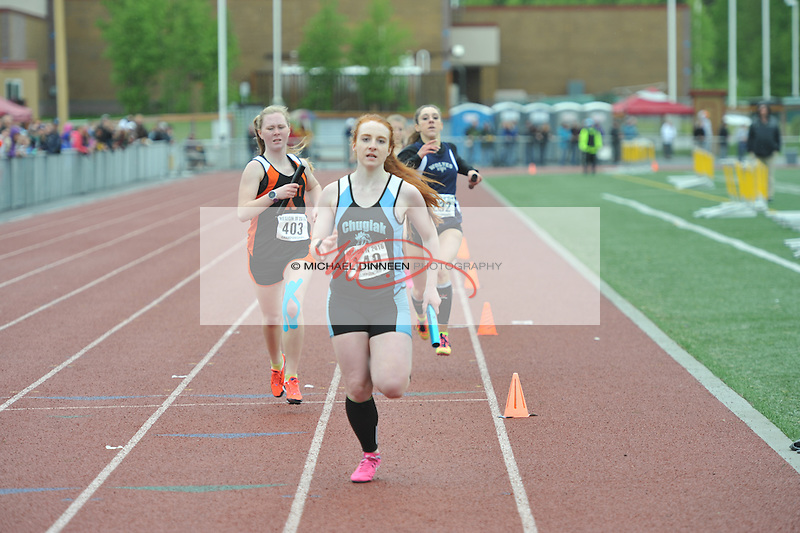 Chugiak's Reilly Hall finishes her championship winning anchor leg of the 4x400 relay at the Region IV Track and Field Championships.  Photo by Michael Dinneen for the Star