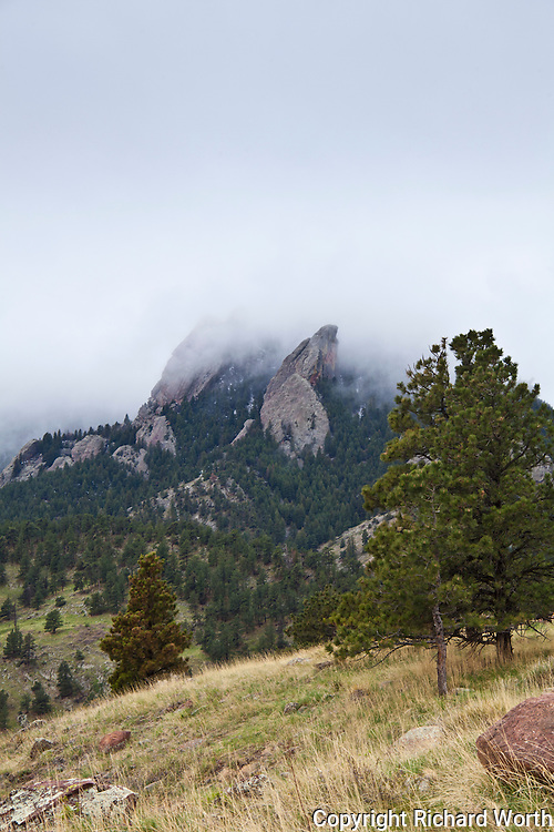 West of Boulder, Bear Peak stands shrouded in clouds.