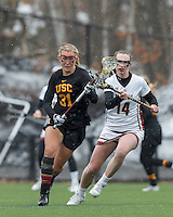 Newton, Massachusetts - March 30, 2015: NCAA Division I. Boston College (white) defeated USC (black), 16-12, at Newton Campus Field at Boston College.