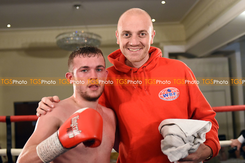 Darren Murray (blue shorts) defeats Ali Wyatt during a Boxing show at the Rockingham Forest Hotel, Corby, England on 11/09/2015