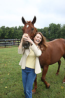 "{September 18, 2009} {11am} -- Culpeper, VA. -- Author Jeannette Walls poses with her horse Jackson at her farm in Culpeper, VA. Walls has written a book called ""Half-Broke Horses: A True Life Novel."" The book is about her grandmother who was a wild west woman who broke horses.. -- ...Photo by Andrew B. Shurtleff, Freelance."