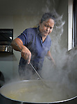 Juani Martinez cooks food for Cuban immigrants in Nuevo Laredo, Mexico, on March 3, 2017. Hundreds of Cubans are stuck in the border city, caught in limbo by the elimination in January of the infamous &ldquo;wet foot, dry foot&rdquo; policy of the United States. They are not allowed to enter the U.S. yet don&rsquo;t want to return to Cuba. Many of the city&rsquo;s churches have become temporary shelters for the immigrants, and congregations rotate responsibility for feeding the Cubans, who have slowly been forced to appreciate Mexican cuisine. Martinez is a member of the Aposento Alto Methodist Church in Nuevo Laredo, and is cooking in the city's Divino Salvador Methodist Church. <br /> <br /> Such solidarity from ordinary Mexicans is being tested these days, as not only are the Cubans stuck at the border, but the U.S. has stepped up deportations of Mexican nationals, while at the same time detaining many undocumented workers from other nations and simply dumping them on the US-Mexico border.