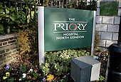 The main entrance sign of Priory Hospital, Southgate, London, England. Royalty Free