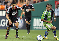 Pablo Hernandez #21 of D.C. United races for the ball with Tyrone Marshall #14 of Seattle Sounders FC during an MLS match at RFK Stadium on July 15 2010, in Washington DC.Seattle won 1-0.
