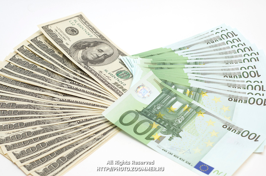 Many banknotes (Euro and Dollars) in pile isolated on white background