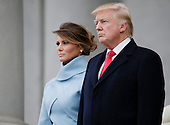 United States President Donald Trump stands with First Lady Melania Trump stand at the top of the stairs at the Capitol Building before departing for the parade after Trump is sworn in at the 58th Presidential Inauguration on Capitol Hill in Washington, D.C. on January 20, 2017.   <br /> Credit: John Angelillo / Pool via CNP