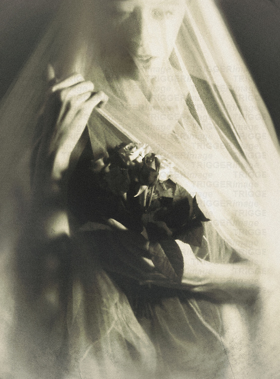 A veiled female with a ghostly expression, holding a bunch of roses in one hand, and her veil in another.