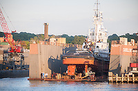 An tugboat undergoes repairs at the Caddell Dry Dock and Repair facility on the Kill Van Kull on Staten Island in New York on Thursday, June 30, 2016.   (© Richard B. Levine)